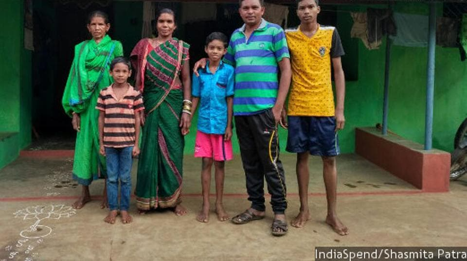 Dashrath Majhi (second from right) with his family. A job at a local alumina refinery has helped him pull his family out of poverty and hunger and into moderate prosperity. A quarter of Indians remain as deprived as Majhi's family were three decades ago, and the most glaring evidence of their poverty is their undernutrition.