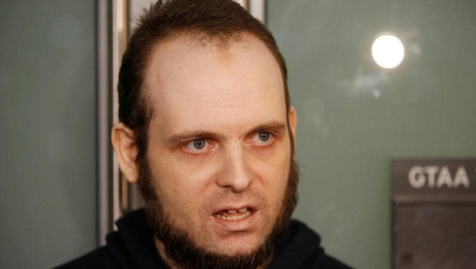 Joshua Boyle speaks to the media after arriving with his wife and three children at Toronto Pearson International Airport, nearly 5 years after he and his wife were abducted in Afghanistan in 2012 by the Taliban-allied Haqqani network, in Toronto, Ontario.