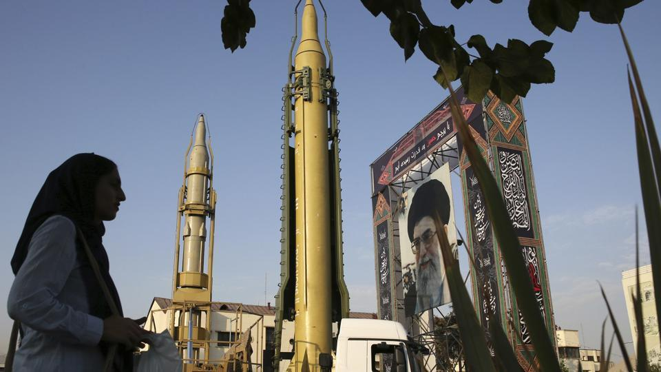 A Ghadr-H missile, a Sejjil missile and a portrait of the Supreme Leader Ayatollah Ali Khamenei are displayed at Baharestan Square in Tehran, Iran.