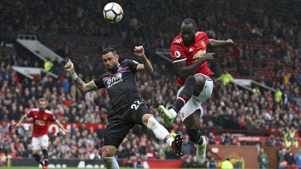 Manchester United's Romelu Lukaku, right, and Crystal Palace's Damien Delaney battle for the ball during the English Premier League football match at Old Trafford, Manchester, September 30, 2017. Lukaku will test Liverpool's defence at Anfield on Saturday.