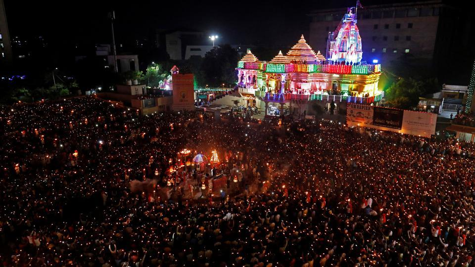 Navratri  celebrations in Surat. Since the imposition of the act, the owners of land and other immovable properties will have to seek the collector's permission before selling their assets.