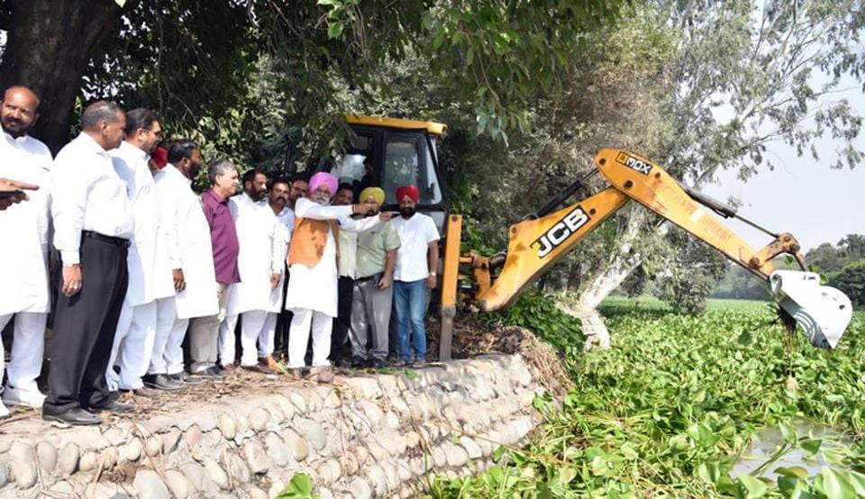 Punjab irrigation minister along with local congress workers inspecting cleanliness work at Kanjali Wetland on Saturday.