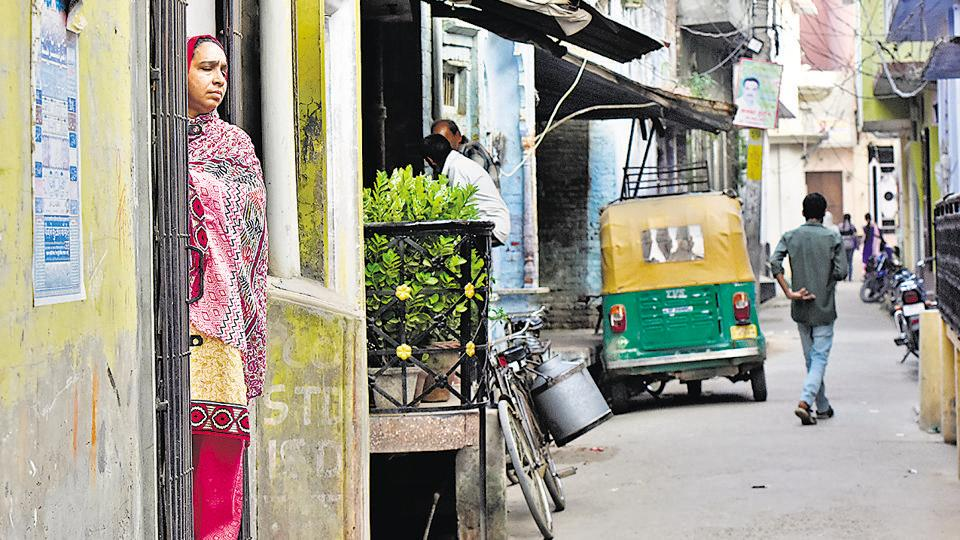 Fatima Nafees stands at the gate of her home at Mohalla Bendotola in Budaun, UP, on Wednesday.