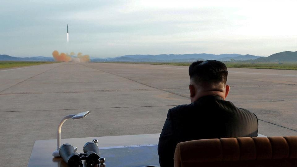 North Korean leader Kim Jong Un watches the launch of a Hwasong-12 missile in this undated photo released by North Korea's Korean Central News Agency.
