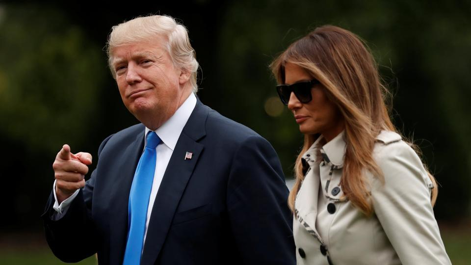 US President Donald Trump and first lady Melania Trump return to the White House in Washington, DC.