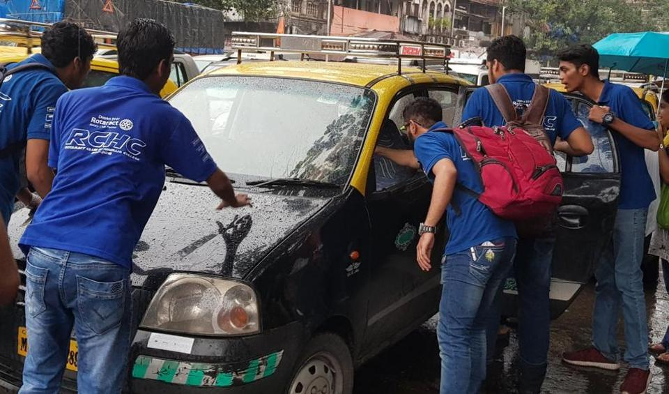 Students of KPB Hinduja College of Commerce confront a taxi driver after her refused to ply short distances.
