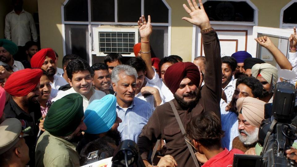 Congress' Sunil Jakhar and minister Navjot Singh Sidhu addressing mediapersons after Congress won the Gurdaspur bypoll by a huge margin, on Sunday.