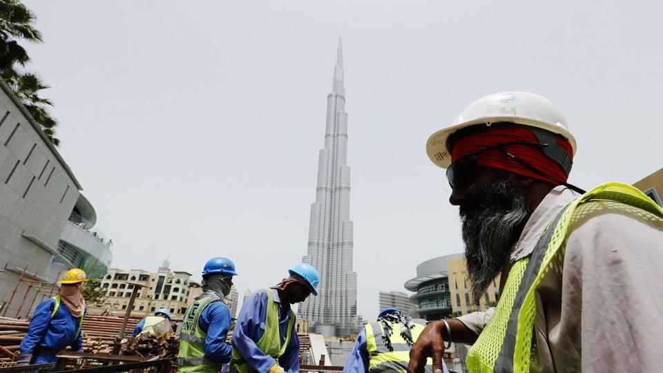 Labourers work near the Burj Khalifa, the tallest tower in the world, in Dubai in this May 9, 2013.