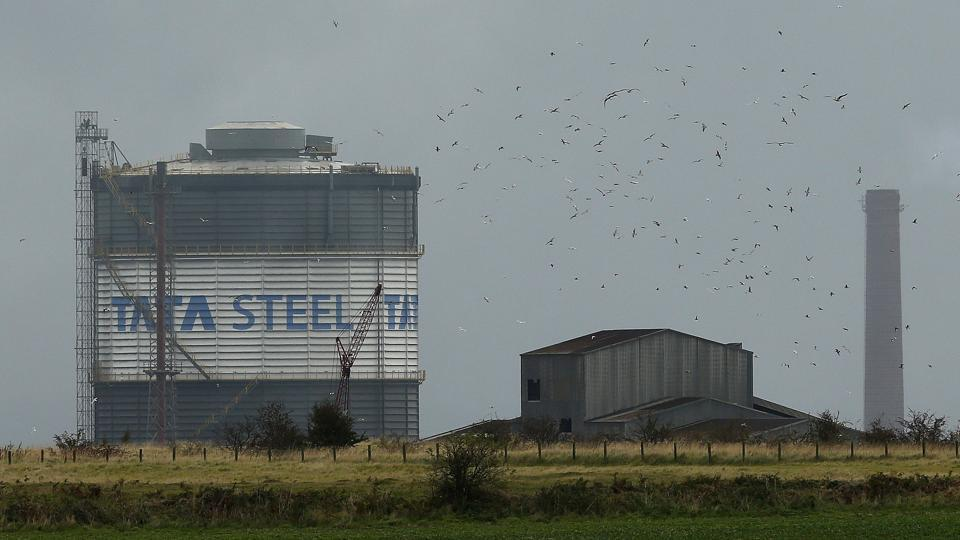 Birds fly above part of the TATA steel plant in Scunthorpe northern England, October 15, 2014.