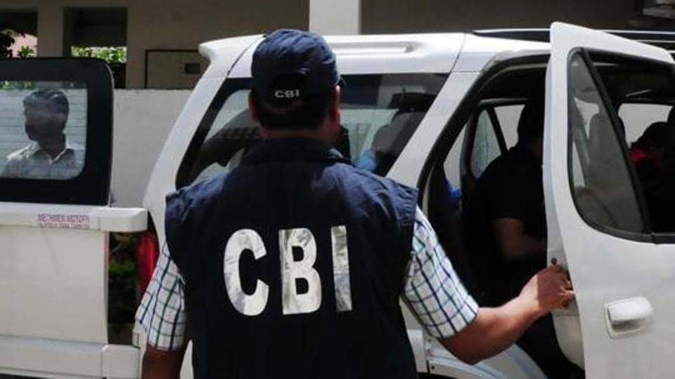 CBI officials coming out of the residence of Nitin Mahindra , main accused in VYAPAM scam, after conducting search in Bhopal.