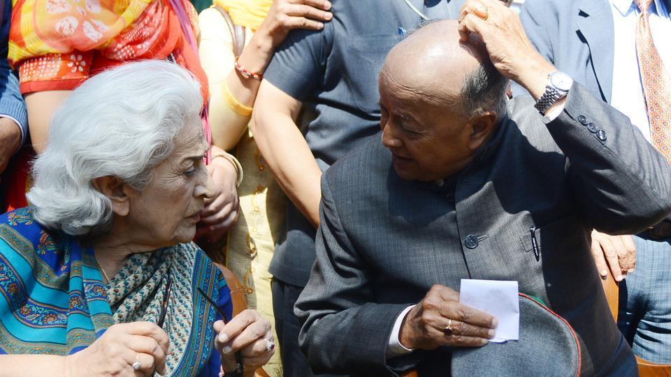Himachal Pradesh chief minister Virbhadra Singhand Irrigation and Public Health Minister Vidya Stokes having a conversation at the CM's official residence Oak Over, on Sunday