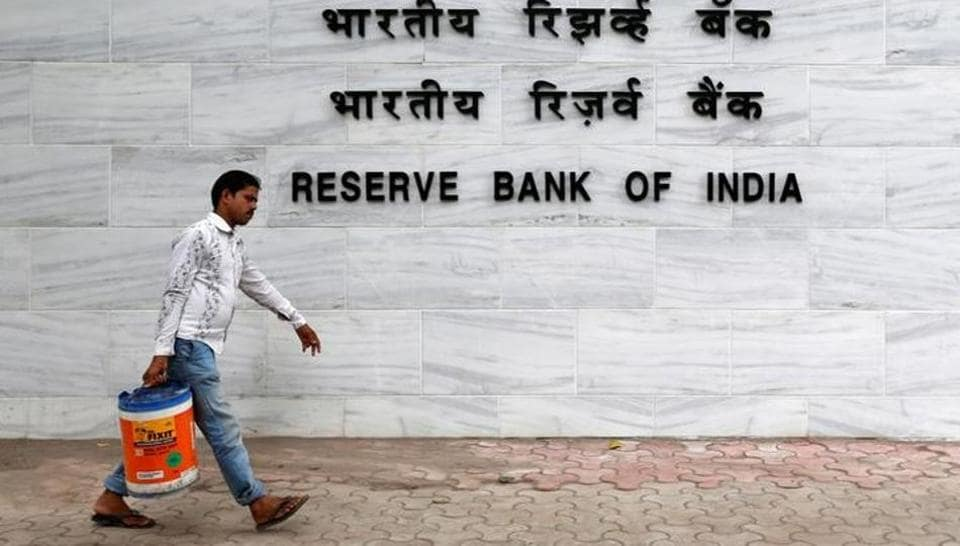 A man walks past the Reserve Bank of India (RBI) head office in Mumbai.