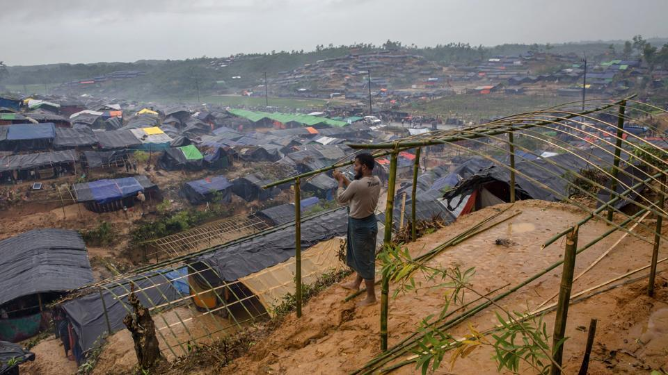 A Rohingya Muslim man, who crossed over from Myanmar into Bangladesh, builds a shelter for his family in Taiy Khali refugee camp, Bangladesh.