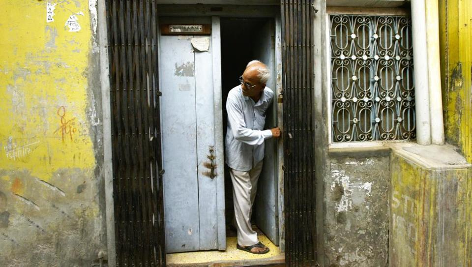 Nafees Ahmad, the father of Najeeb Ahmed, looks out of the door of his house in Vaidon Tola in Budaun. Najeeb Ahmad, an MSc Biotechnology student of JNU, had gone missing from his hostel on October 15, 2016.