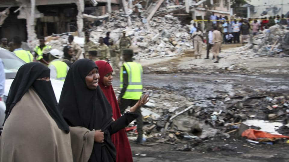 Somali women react at the scene of Saturday's blast, in Mogadishu, Somalia Sunday, Oct. 15, 2017.