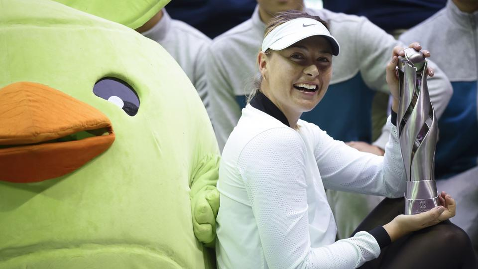 Maria Sharapova holds the Tianjin Open trophy after defeating Aryna Sabalenka in the final.