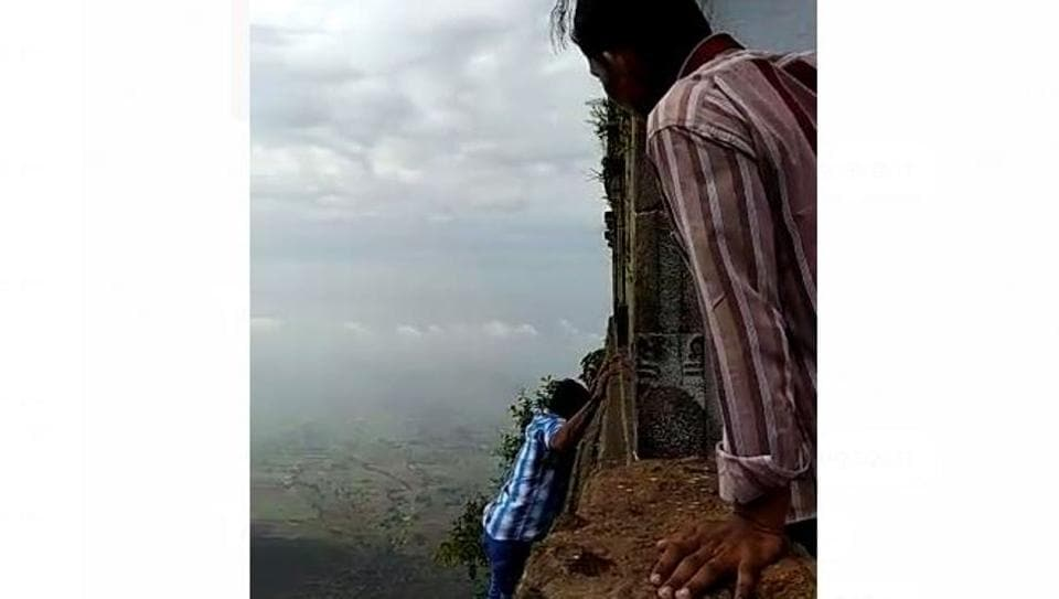 T Arumugam (in the blue shirt), an autorickshaw driver from Musiri town in Tiruchirappalli, moments before he slipped and fell from 2,400 feet while finishing his third circumambulation around the temple on Saturday.