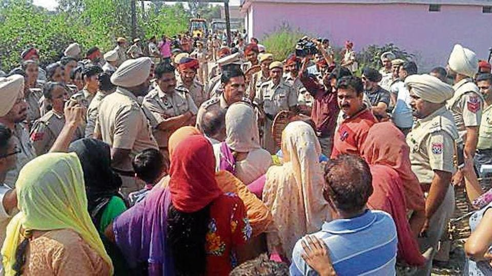Villagers confronting police at Chakmirpur village in Hoshiarpur on Sunday.