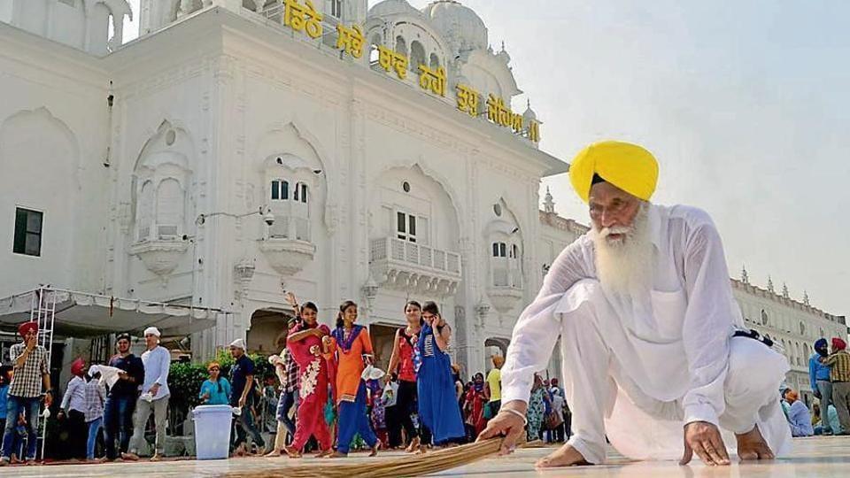 Gurdwara Chhota Ghallughara chief Johar Singh performing sewa outside the Golden Temple in Amritsar on Sunday.