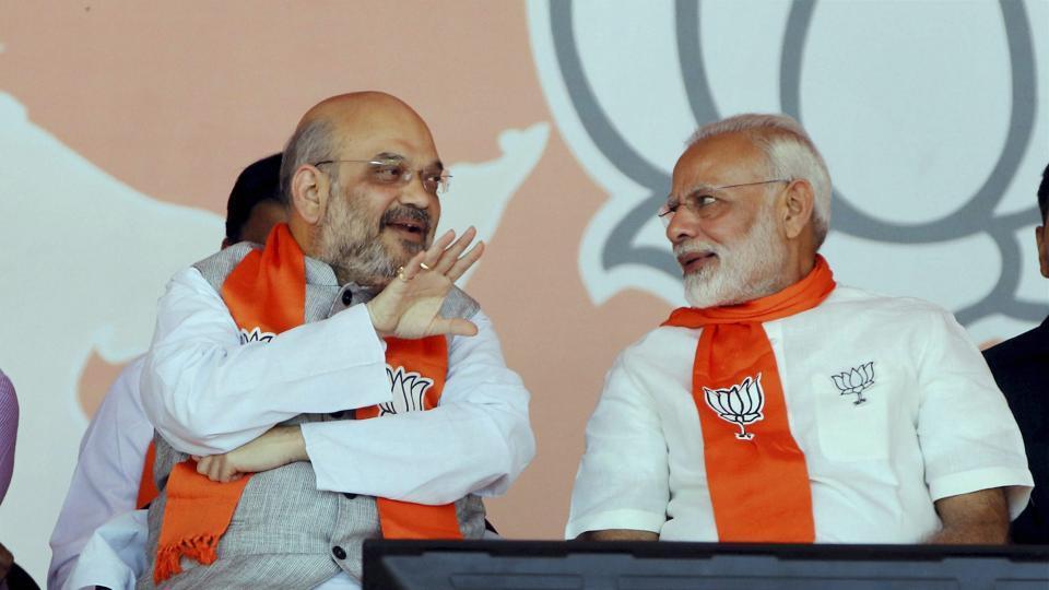 PM Narendra Modi with BJP president Amit Shah during 'Gujarat Gaurav Mahasammelan' in Ahmedabad.
