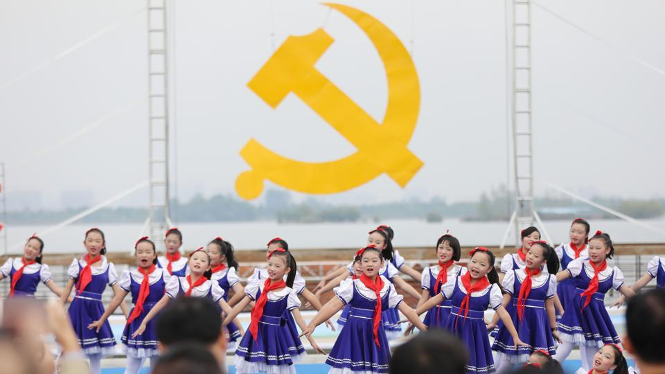 Children perform to welcome delegates to the upcoming 19th Party Congress in China's eastern Anhui province. China's Communist Party opens the twice-a-decade political meeting on October 18, to reshuffle leadership positions.