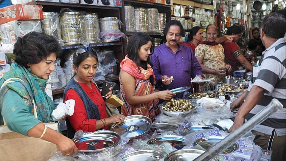 People purchase the utensils in a shop on the occasion of Dhanteras festival in New Delhi.