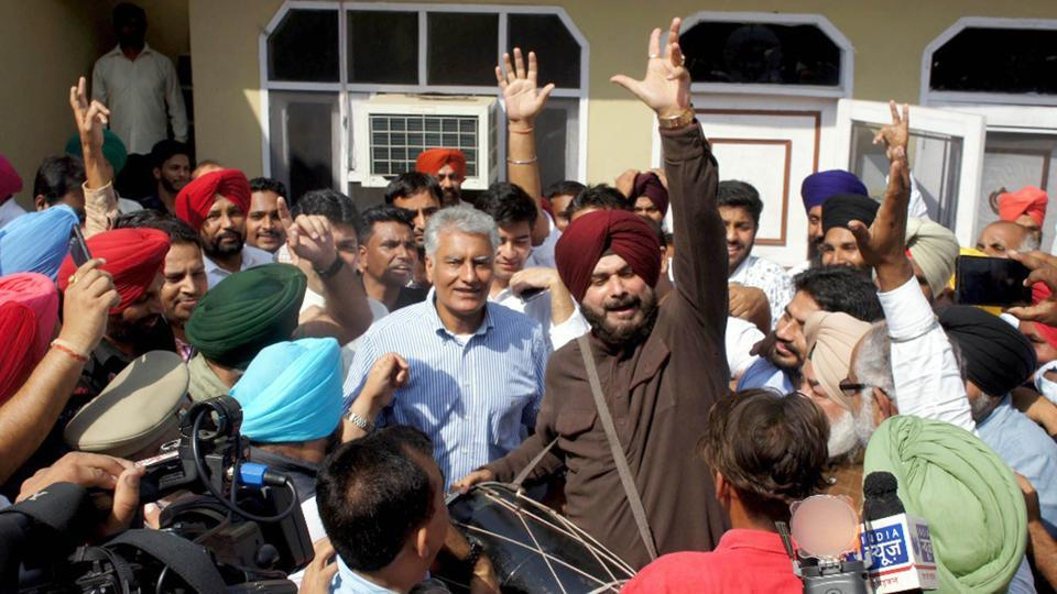 Congress candidate and Punjab Pradesh Congress Committee president Sunil Jakhar and Punjab local codies minister Navjot Singh Sidhu perform bhangra after his victory in Gurdaspur Lok Sabha bypoll on October 15, 2017.