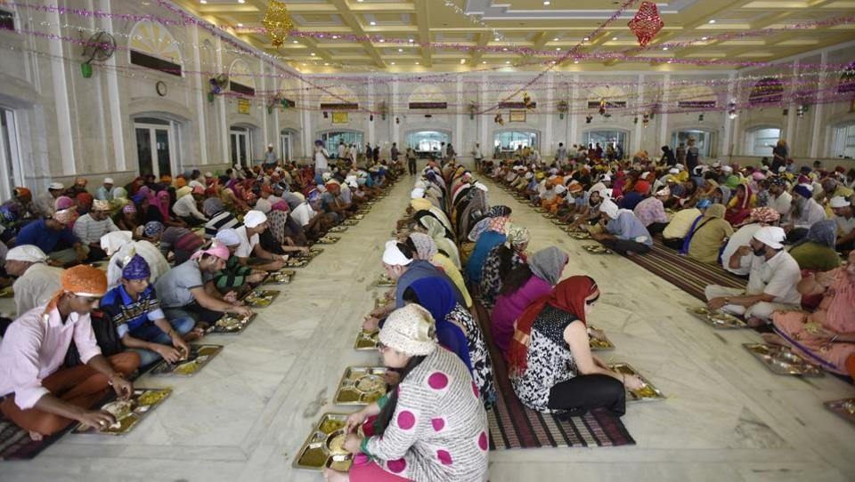 At a time when food security is a global concern, the tradition of 'langar' in Gurudwaras is upholding equality between people regardless of their socio-economic status by offering everyone who visits a free, wholesome meal. This is the langar hall at Bangla Sahib in New Delhi. (Raj K Raj / HT Photo)