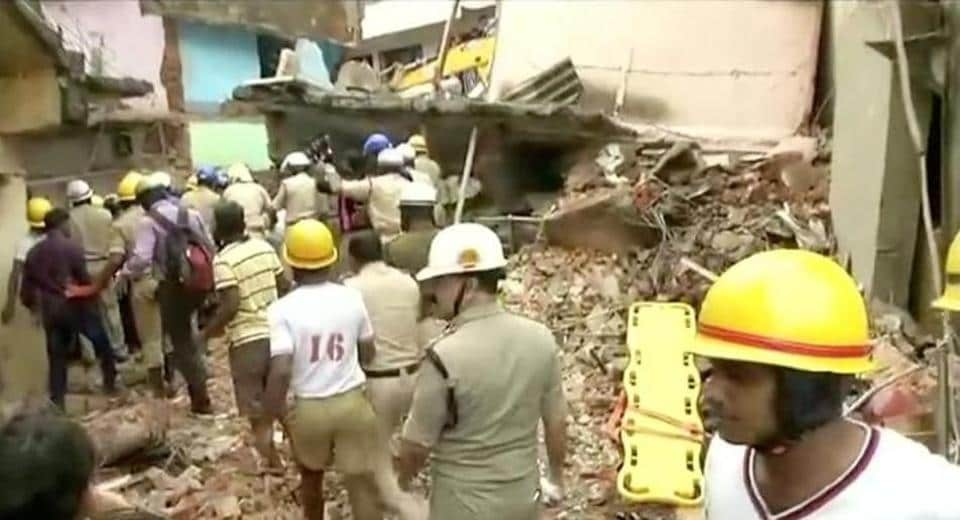 Rescue workers are seen following a building collapse in Bengaluru, Karnataka, India in this still frame taken from video October 16, 2017.