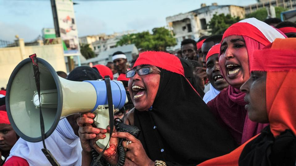 People chant slogans as they protest against the attack in Mogadishu on Sunday. The US condemned the bombing 'in the strongest terms' in a statement released by the State Department. British Foreign Secretary Boris Johnson and French President Emmanuel Macron also joined in condemning the attacks, expressing solidarity with Somalia. Turkey, a leading donor and investor in the African nation has also promised to provide medical aid to the country. (Mohamed Abdiwahab / AFP)