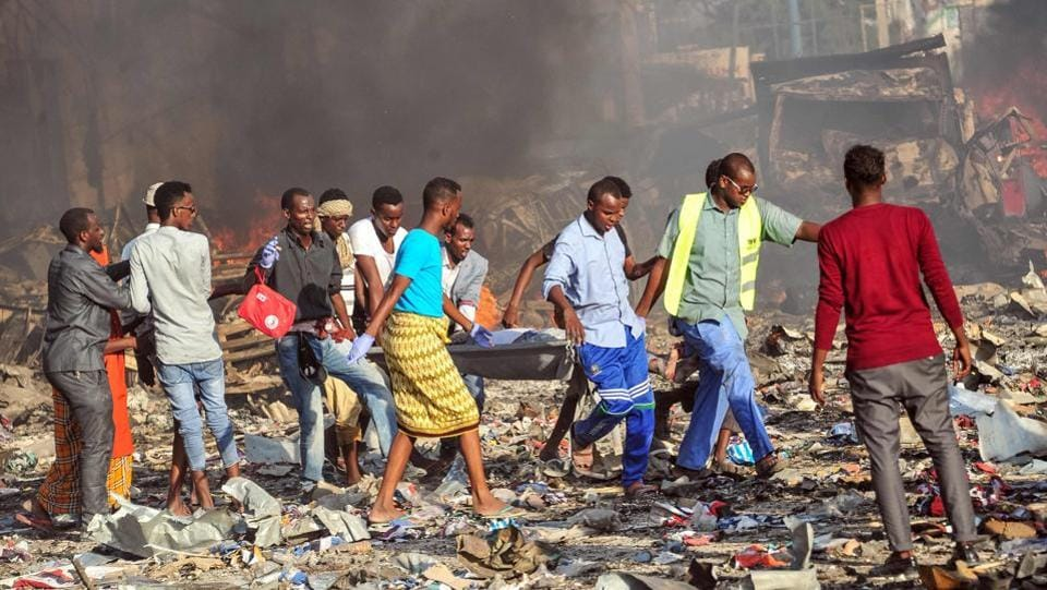 It was only after emergency workers began pulling body after body from the rubble of the nearly levelled downtown street over the weekend that the true magnitude of the attack came into sharper focus. (Mohamed Abdiwahab / AFP)