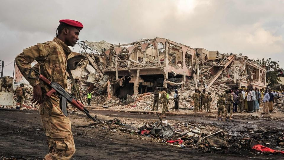 A Somali soldier patrols the scene of the explosion in the centre of Mogadishu. While there has been no immediate claim of responsibility, suspicion immediately fell on  Al-Shabaab, a militant group aligned with Al-Qaeda, which has carried out dozens of similar bombings in its bid to overthrow Somalia's internationally backed government. (Mohamed Abdiwahab / AFP)