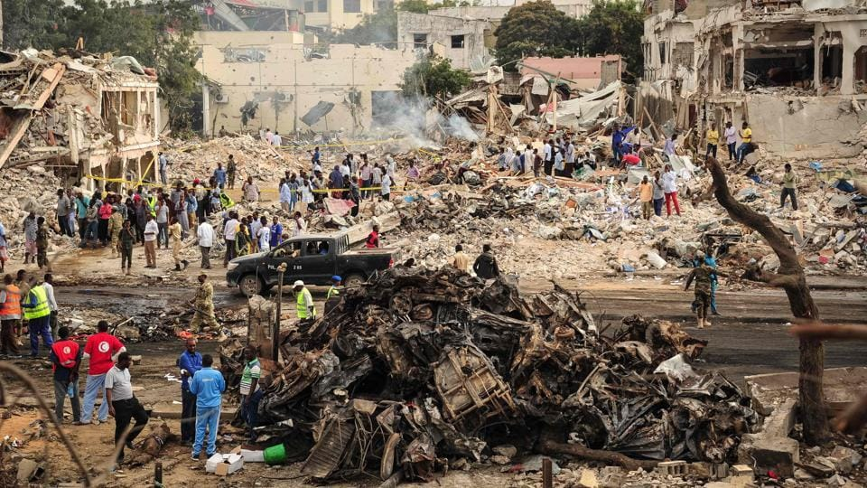 Fires continued to burn well into Sunday at the scene of the bombings. Abshir Ahmed, deputy speaker of the upper House of Parliament, wrote on his Facebook page that the director of one hospital had told him at least 130 bodies there were burnt beyond recognition. (Mohamed Abdiwahab / AFP)