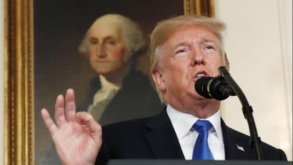 U.S. President Donald Trump speaks about Iran and the Iran nuclear deal in front of a portrait of President George Washington in the Diplomatic Room of the White House in Washington, U.S., October 13, 2017.