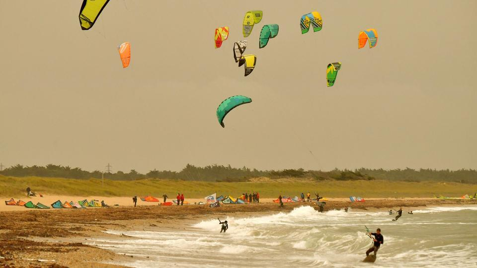 Kite surfers brave the winds in Quiberon, western France as gusts of 80 mph (130 kph) were reported. Irish Prime Minister Leo Varadkar urged people to stay indoors until the storm passed with the Royal National Lifeboat Institution, warning those outdoors that as tempting as it is to watch tides crashing, it wasn't worth the risk of being struck by large waves. (Loic Venance / AFP)