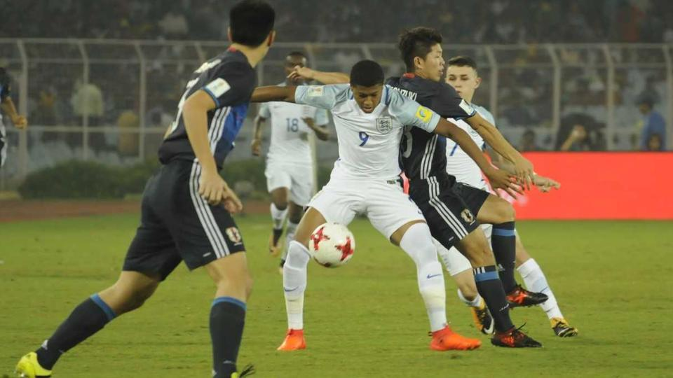 England and Japan players vie for the ball during their Round of 16 encounter. (samir jana/ht photo)
