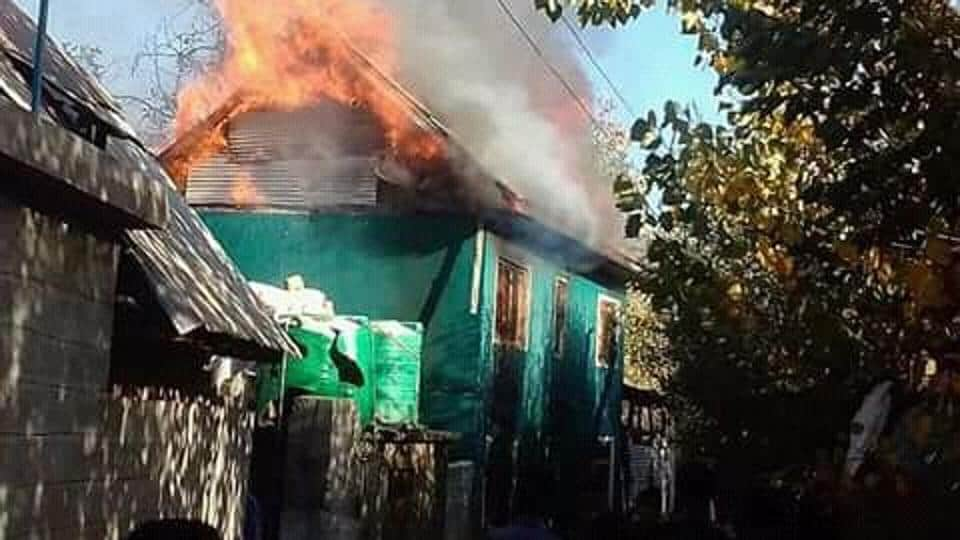 The house of the former sarpanch that was set on fire in Shopian. (ANI Twitter)