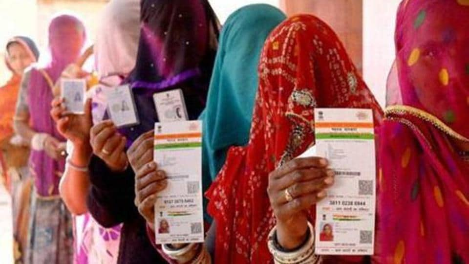 File photo of Rajasthani women showing their Aadhaar cards before a vote in Ajmer.