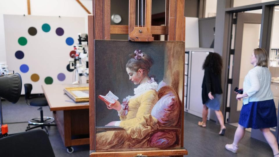 Young Girl Reading by Jean-Honoré Fragonard on an easel at the National Gallery of Art in Washington, DC.