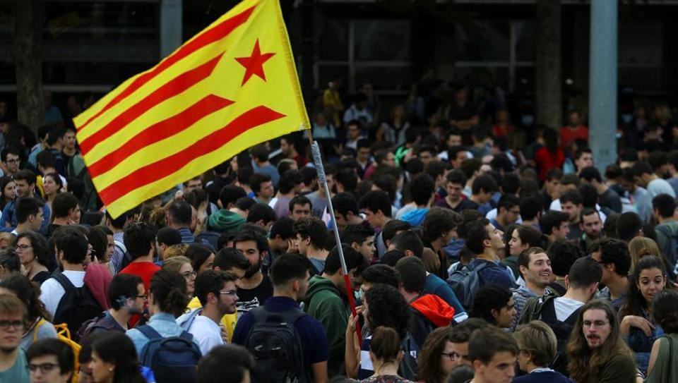 Students wave an Estelada (Catalan separatist flag) during a gathering to protest against the imprisonment of leaders of two of the largest Catalan separatist organizations, Catalan National Assembly's Jordi Sanchez and Omnium's Jordi Cuixart, who were jailed by Spain's High Court, in Barcelona, Spain, October 17, 2017.