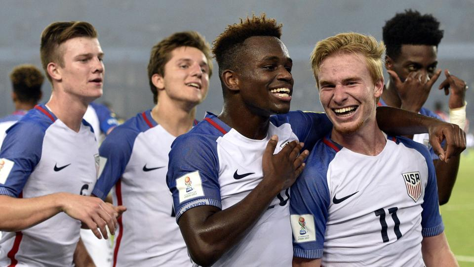 Tim Weah (2nd right) and Andrew Carleton (right) of USA celebrate the third goal against Paraguay during their FIFAU-17 World Cup round of 16 match at Jawaharlal Nehru Stadium in New Delhi on Monday.