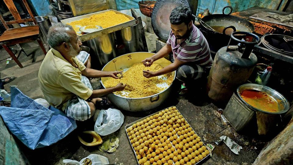Diwali is arguably India's biggest festival, celebrated with much fanfare and never without a large share of sweets. Here in Kolkata, men are seen busy making 'laddoos' at a sweet shop.  (Swapan Mahapatra / PTI)