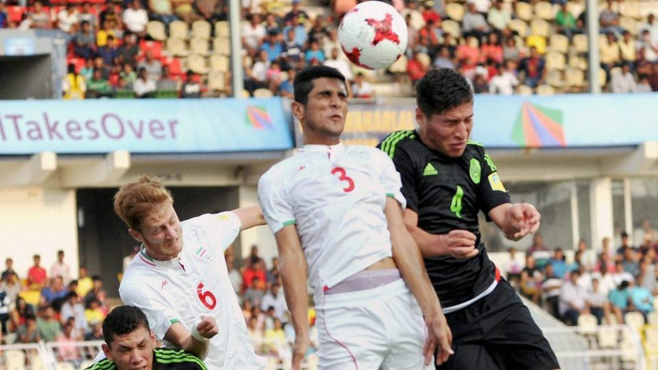 Players of Iran and Mexico in action during their FIFA U-17 World Cup match at Nehru Stadium, Fatorda in Goa. (PTI)