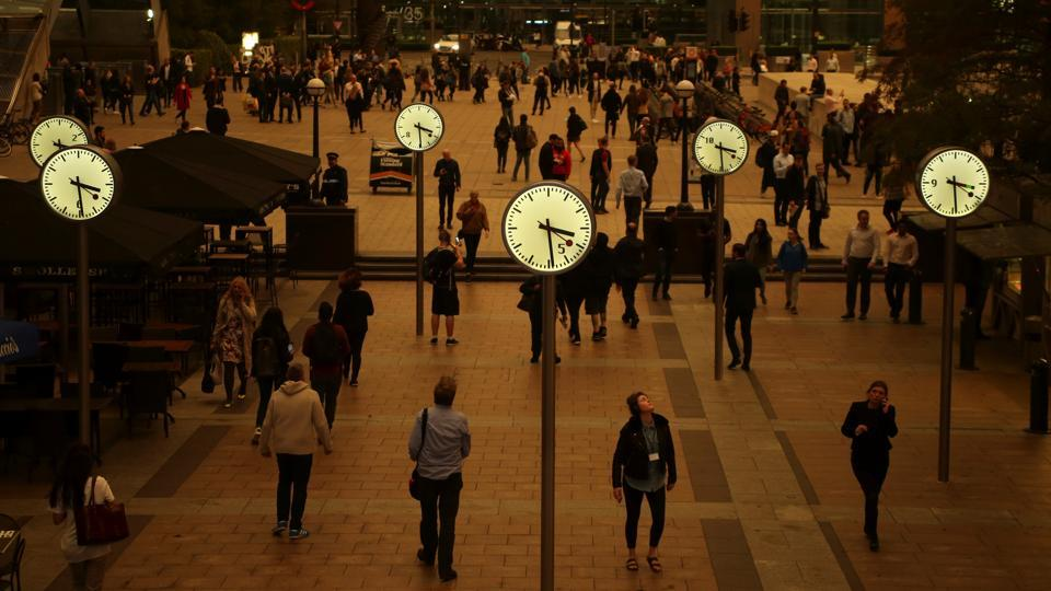 People walk through Canary Wharf while the sky overhead turns ochre over London. Apart from the unusual skies, several EasyJet flights to British airports were diverted due to unusual odors on board thought to be associated with the unusual 'atmospheric conditions'. British Airways had similar reports but operated its flights normally. Officials at Liverpool John Lennon Airport said that the conditions caused some flight redirections. (Tom Jacobs / REUTERS)