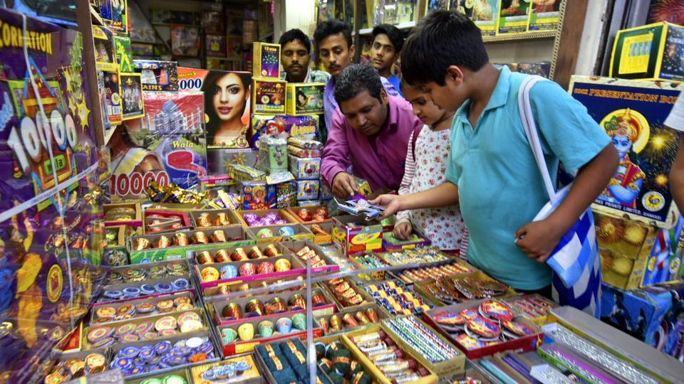 File photo of customers buying firecrackers in New Delhi.