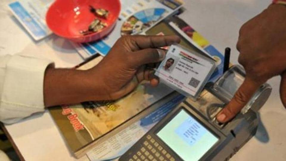 A visitor gives a thumb impression to withdraw money from his bank account with his Aadhaar or Unique Identification (UID) card during a Digi Dhan Mela, held to promote digital payment, in Hyderabad.
