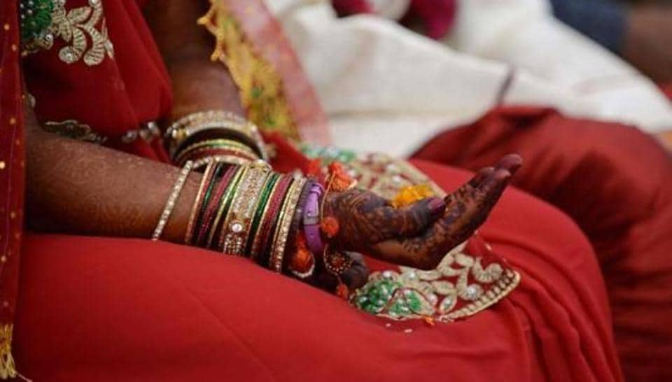 A bride at her wedding ceremony at Bhuvaldi village on the outskirts of Ahmedabad. The UNsaid 27% of India's children get married by age 18 as compared to 28% the world over.