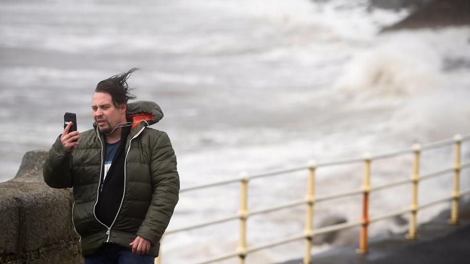 A man attempts a selfie during storm Ophelia in the County Clare town of Lahinch, Ireland. As the storm moves toward Northern Ireland with more to come Tuesday, workers sealed off the Peace Bridge in Londonderry as a precautionary measure. Flights and ferries were cancelled in parts of Scotland and authorities warned of coastal flooding in the southwest. (Clodagh Kilcoyne / REUTERS)