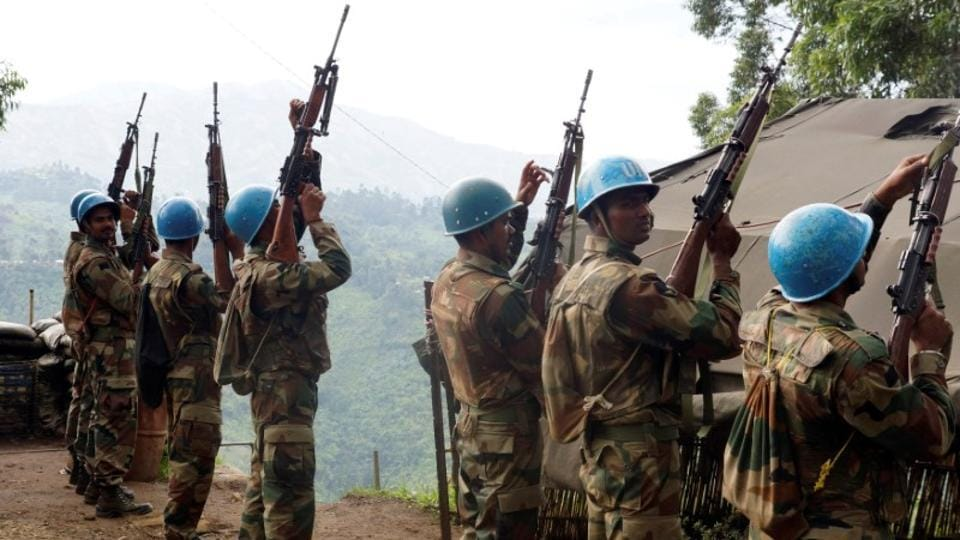 File photo of Indian soldiers, serving in the UN peacekeeping mission in Congo, hold up their weapons at their base after patrolling the villages in Masisi, 88 km (55 miles) northwest of Goma, Congo on October 4, 2013.