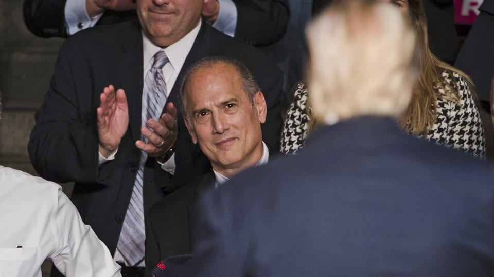 Tom Marino, (L) watches as President-elect Donald Trump (C) departs a rally in Hershey, Pa.